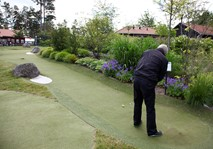 Man playing long Adventure Golf hole