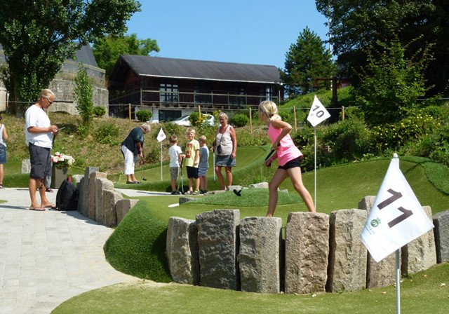 Family at Madsby Legepark Adventure Golf